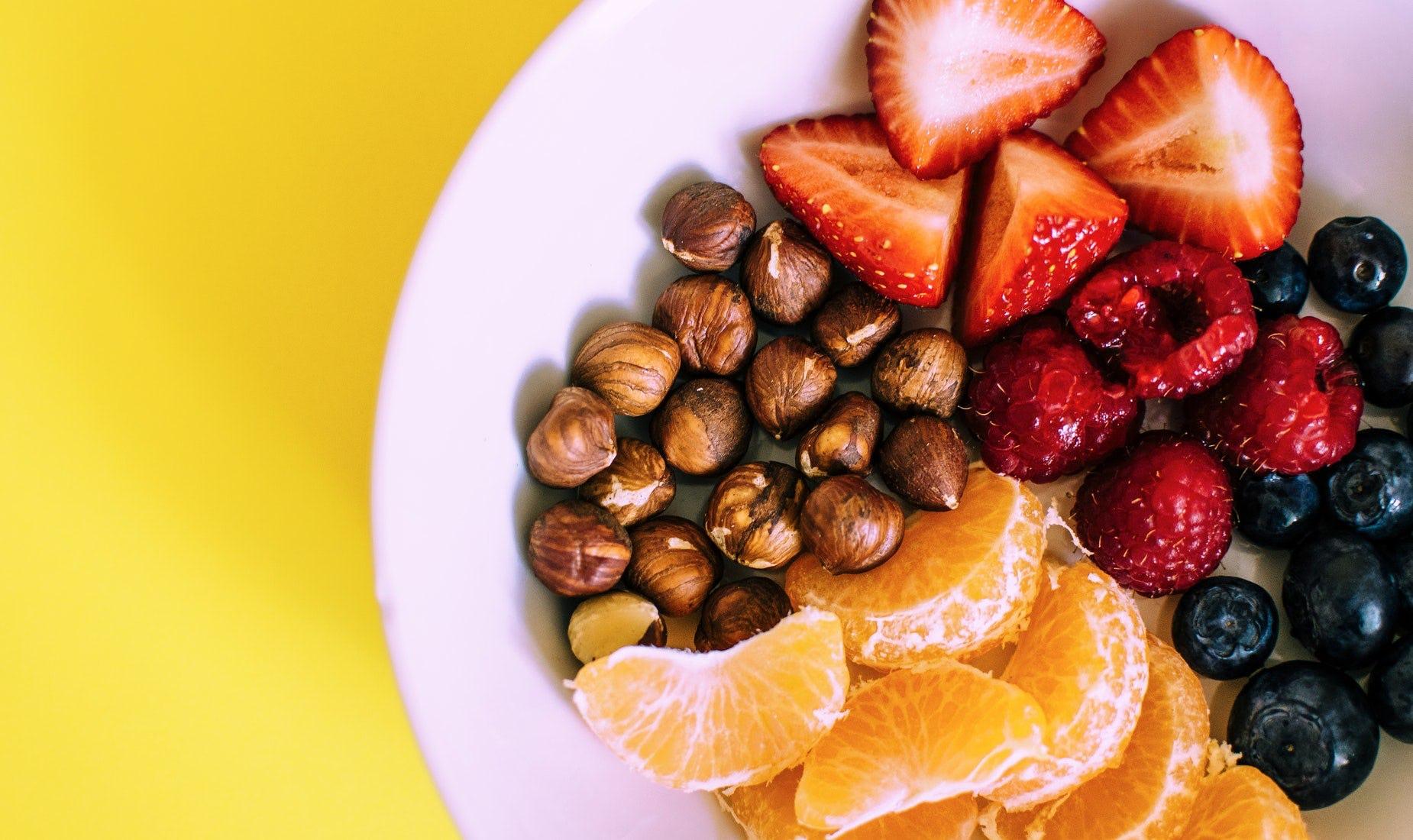 nuts, strawberries, blueberries, nuts, mandarins